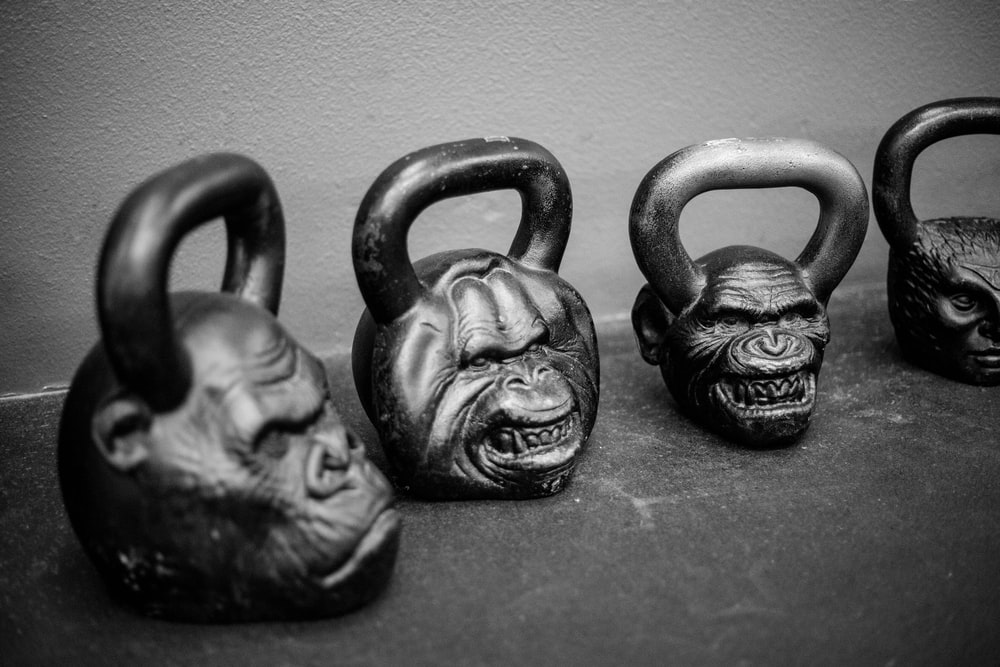four apes kettlebells on pavement