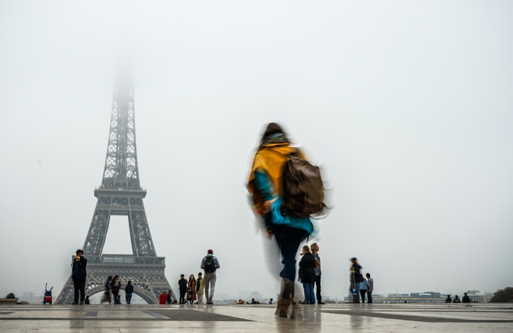 people standing and walking near Eiffel Tower, Paris during day