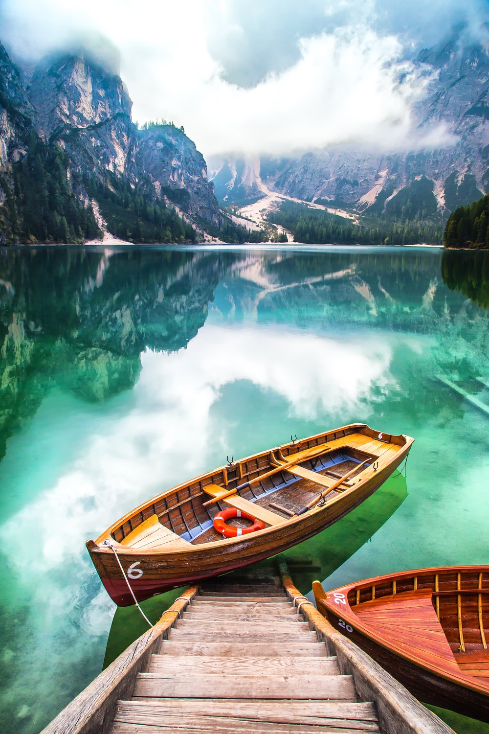 brown gondola on body of water
