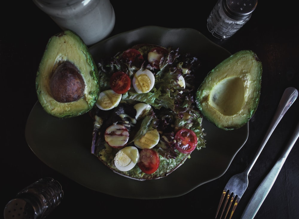 sliced avocado fruit and salad with eggs