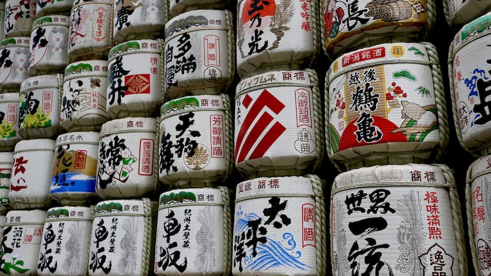 assorted-color kanji text jars