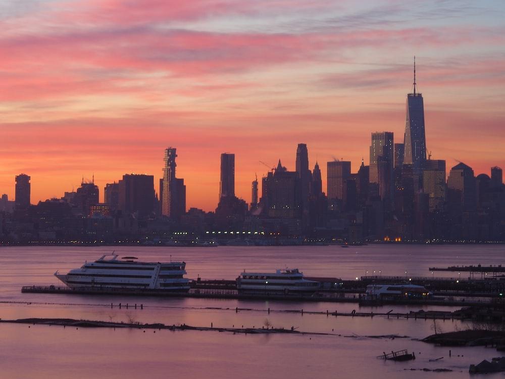 cruise ship on dock near city during daytime