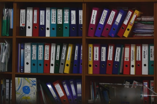 colorful document folders on shelves