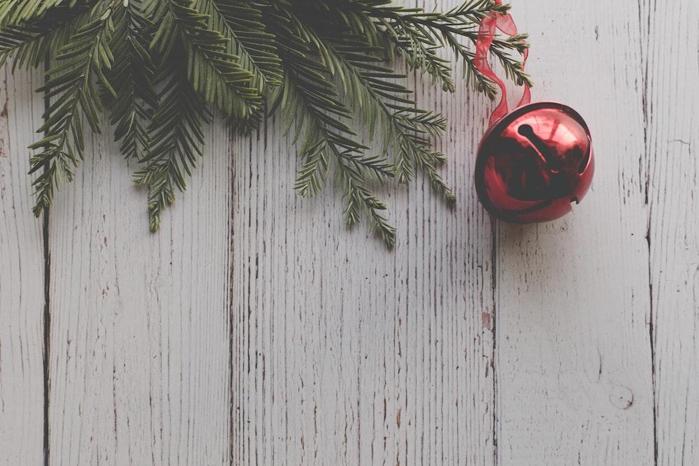 red Christmas ball hangs on tree
