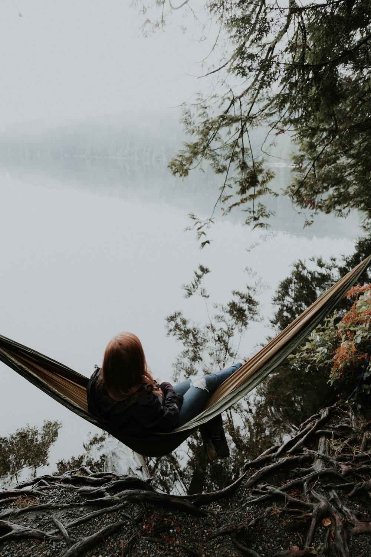 woman sitting on hammock