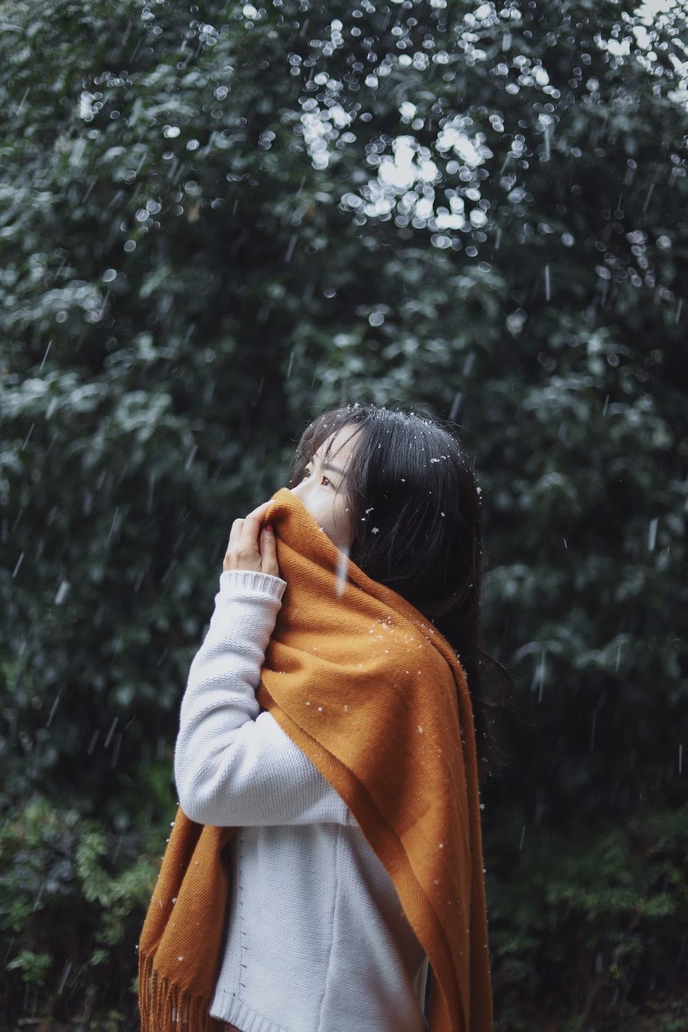 girl stands outdoors in rain