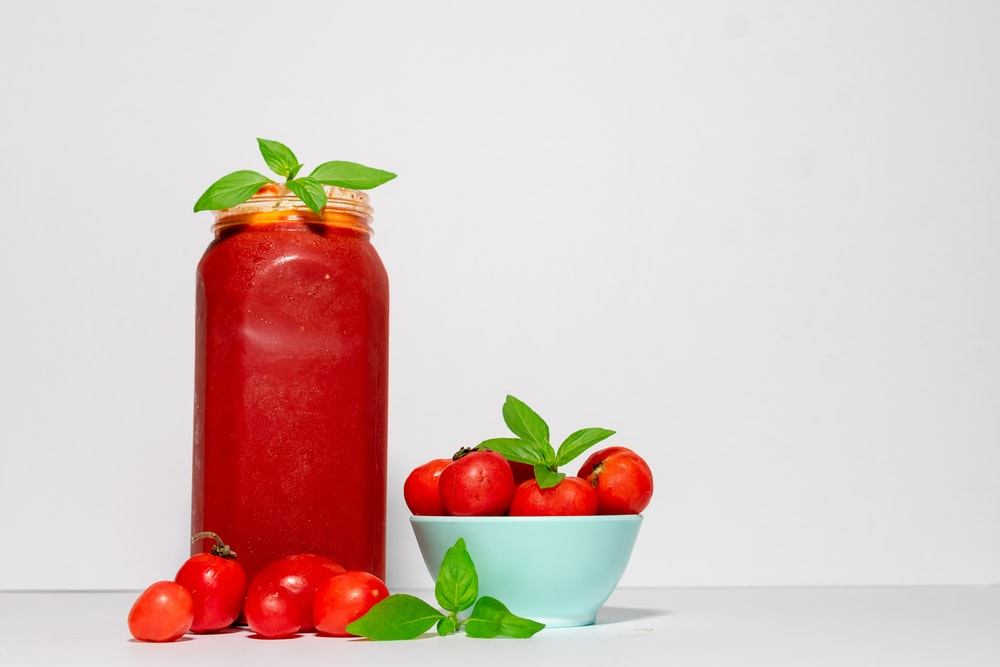 red tomato with jar