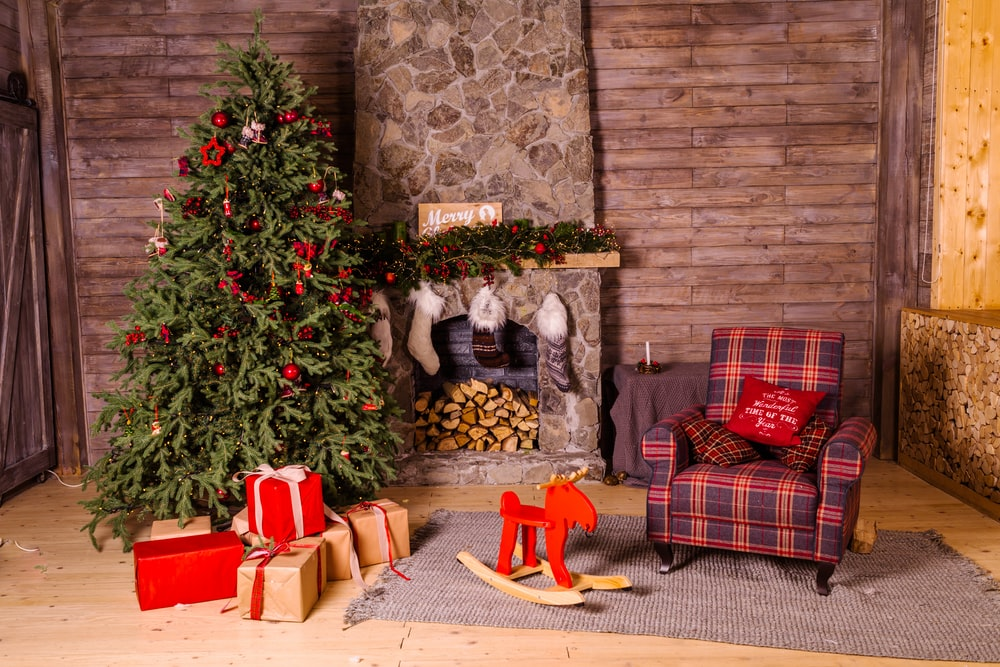 Astounding Green Christmas Tree Beside Red And Brown Fabric Sofa Chair Machost Co Dining Chair Design Ideas Machostcouk
