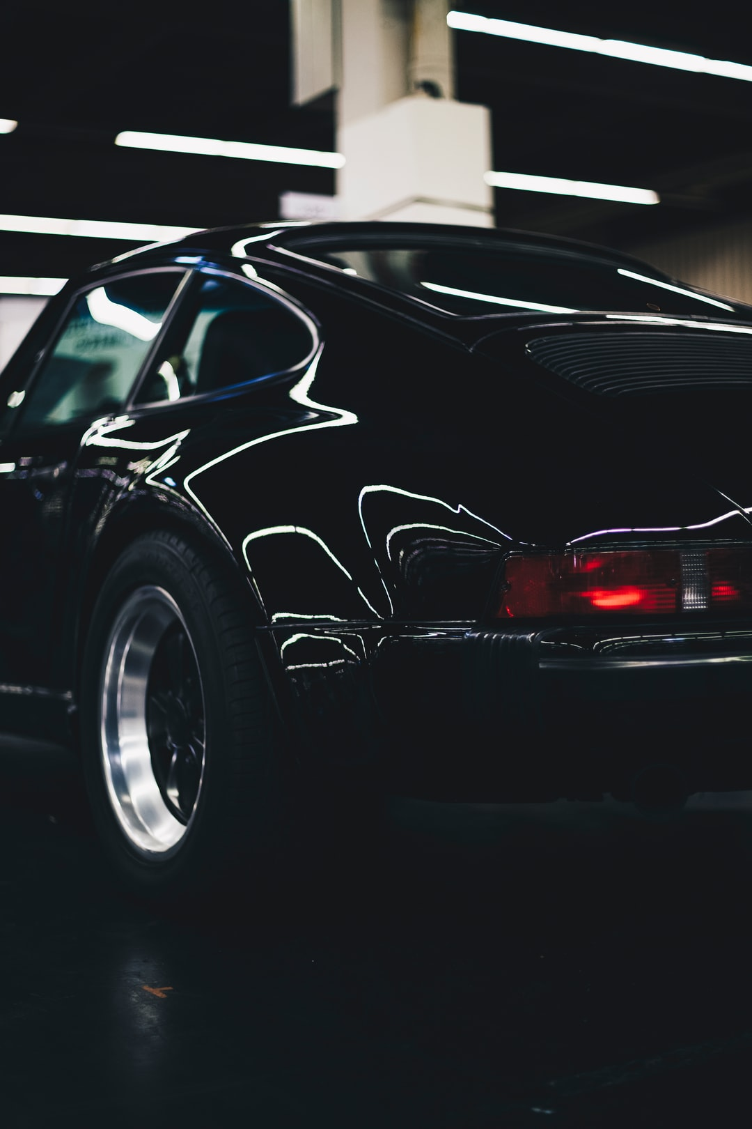 Black Porsche 911 - legendray german vintage classic sports car. Made with Canon 5d Mark III and loved analog lens, Leica Summilux-R 1.4 / 50mm (Year: 1983)