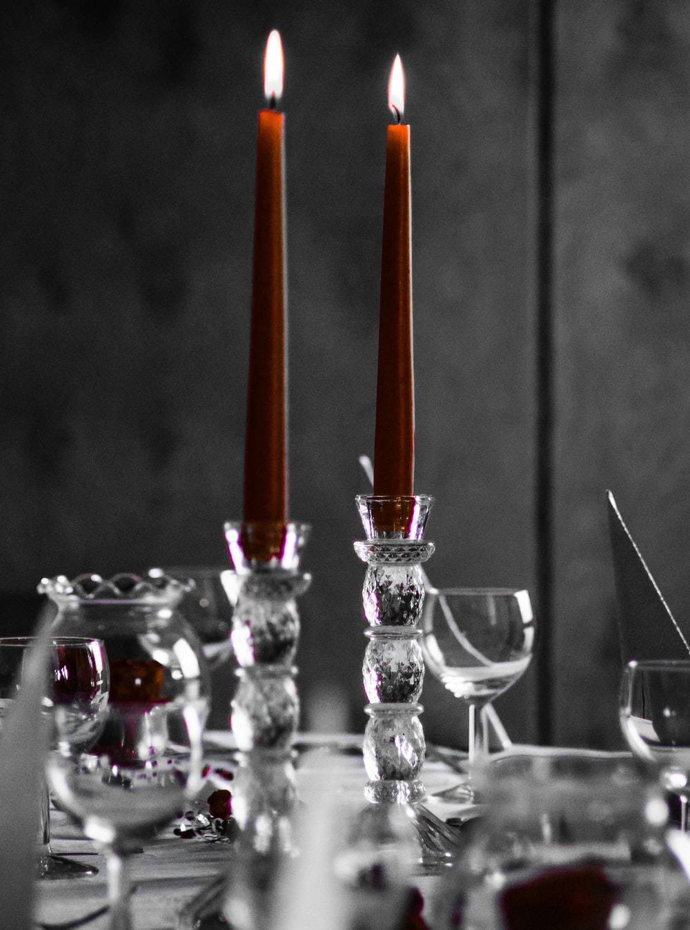 pair of lighted red candles