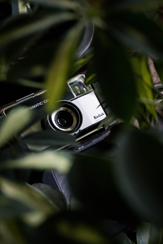 black and silver Nikon Coolpix DSLR camera