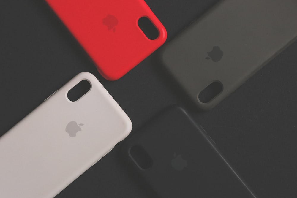 3 assorted-color Apple iPhone cases
