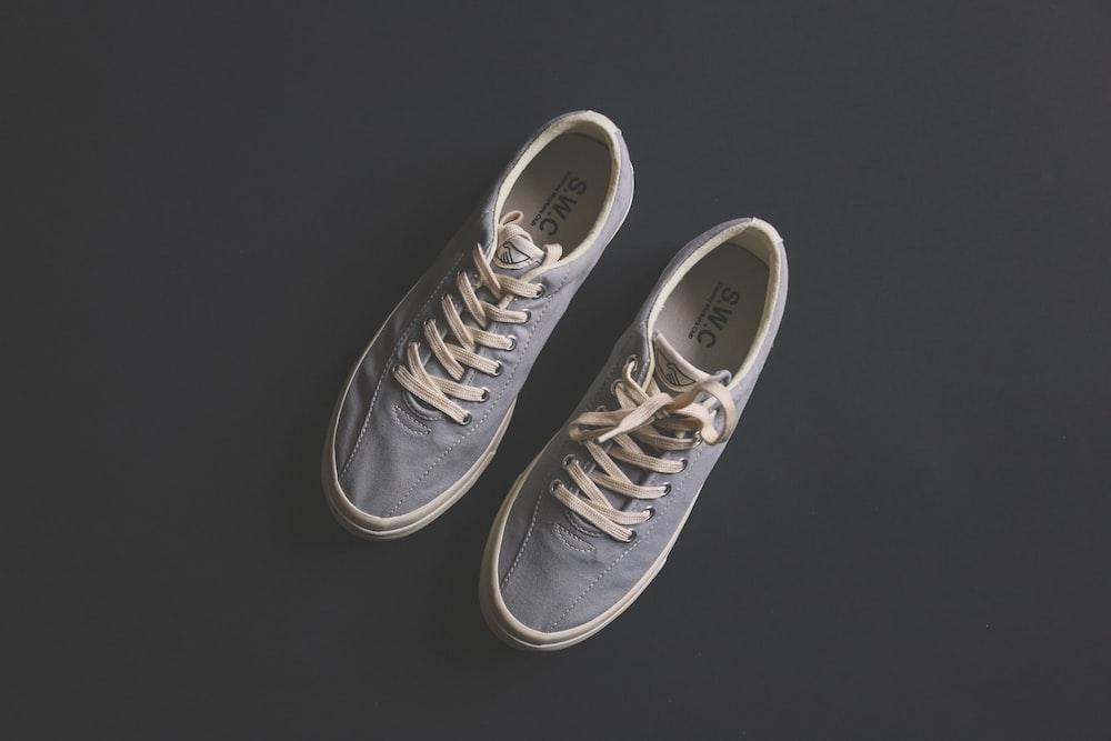 pair of gray SWC low-top sneakers