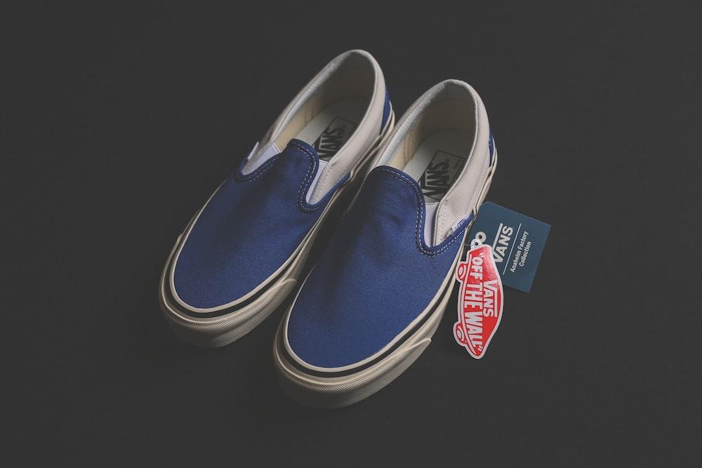pair of blue Vans low-top sneakers