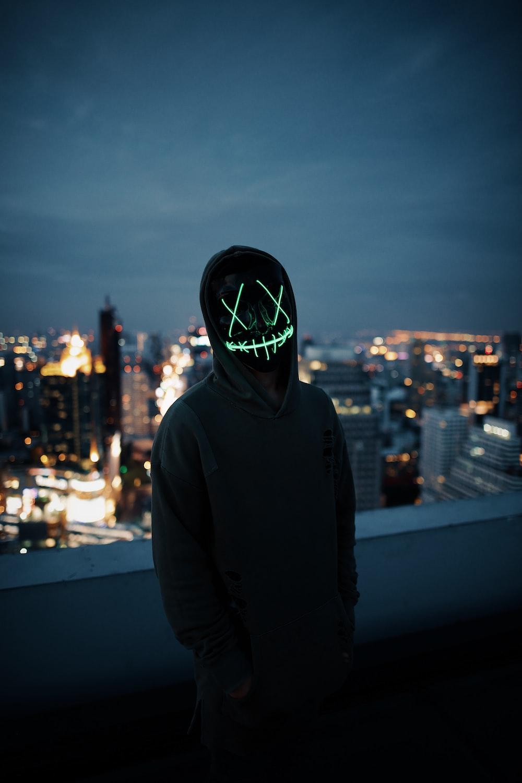 man wearing grey hoodie