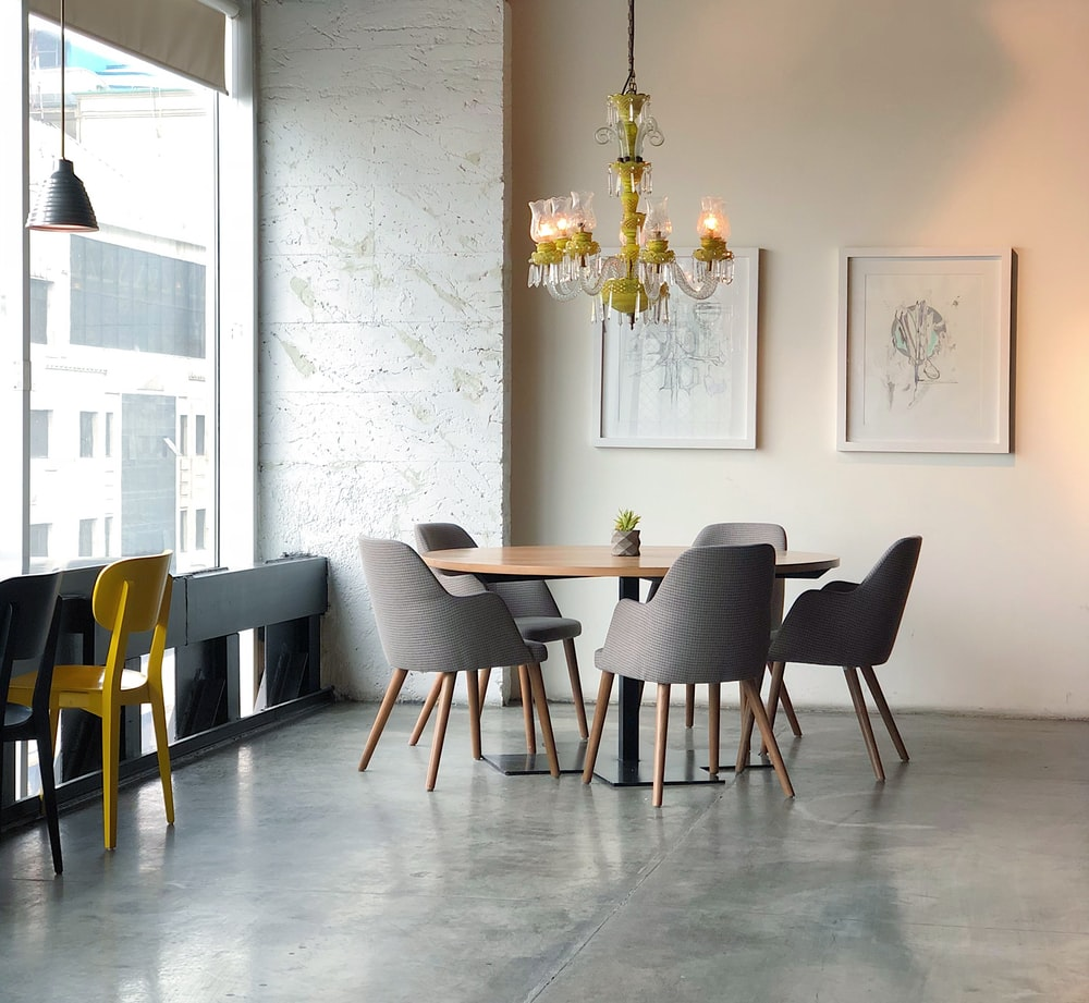 brown and grey dining set inside the room