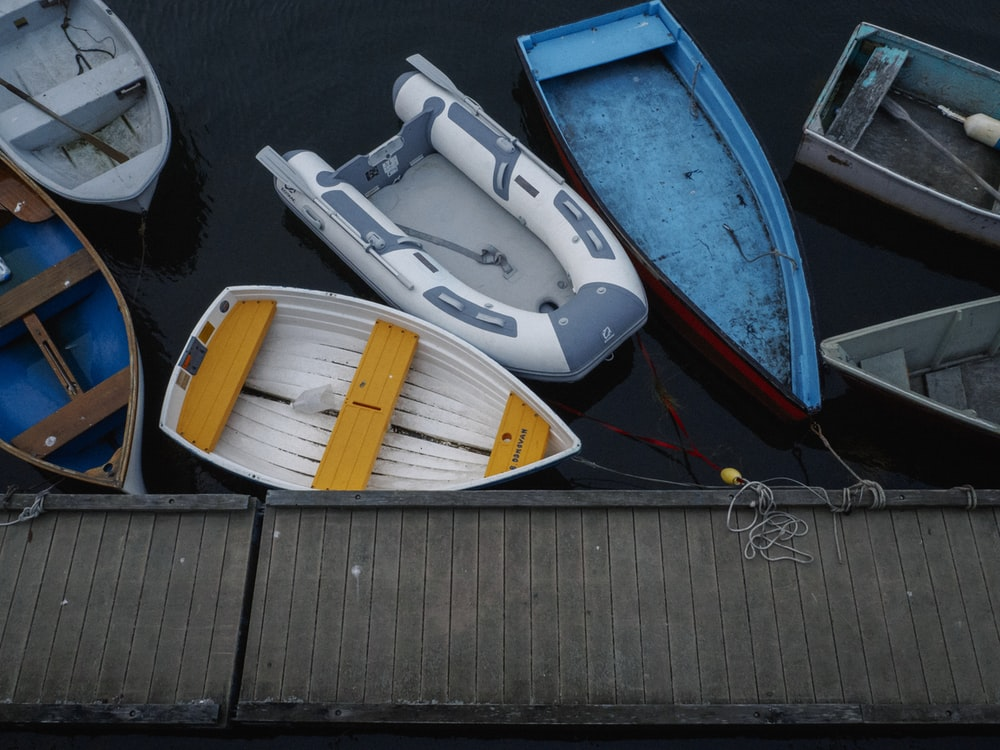 assorted-color boats on body of water