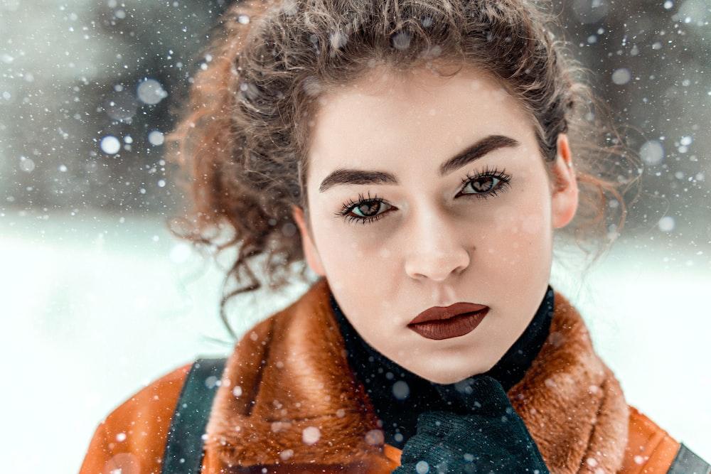 woman in brown and black fur coat