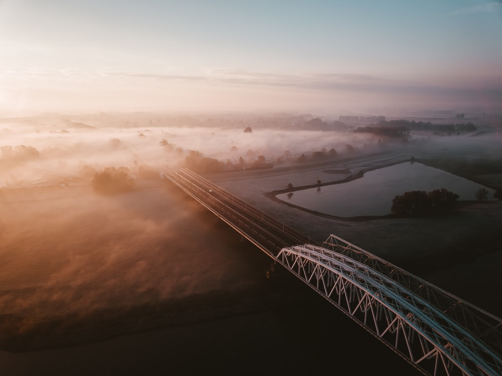 metal bridge over lake