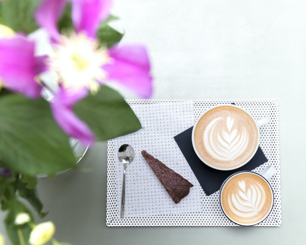 cups of coffee on tray