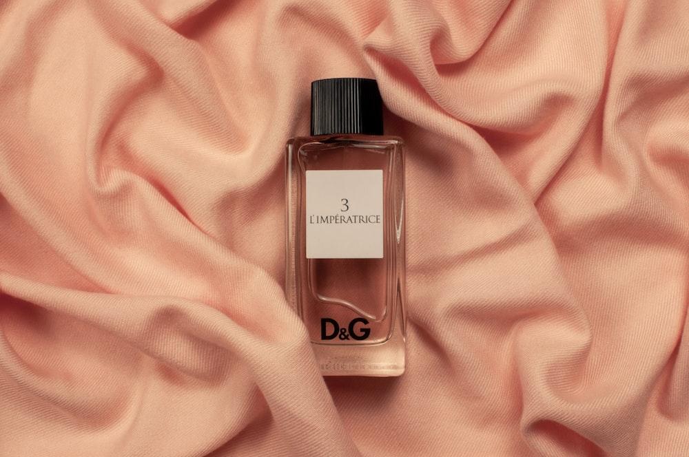 Dolce & Gabbana fragrance bottle on pink textile