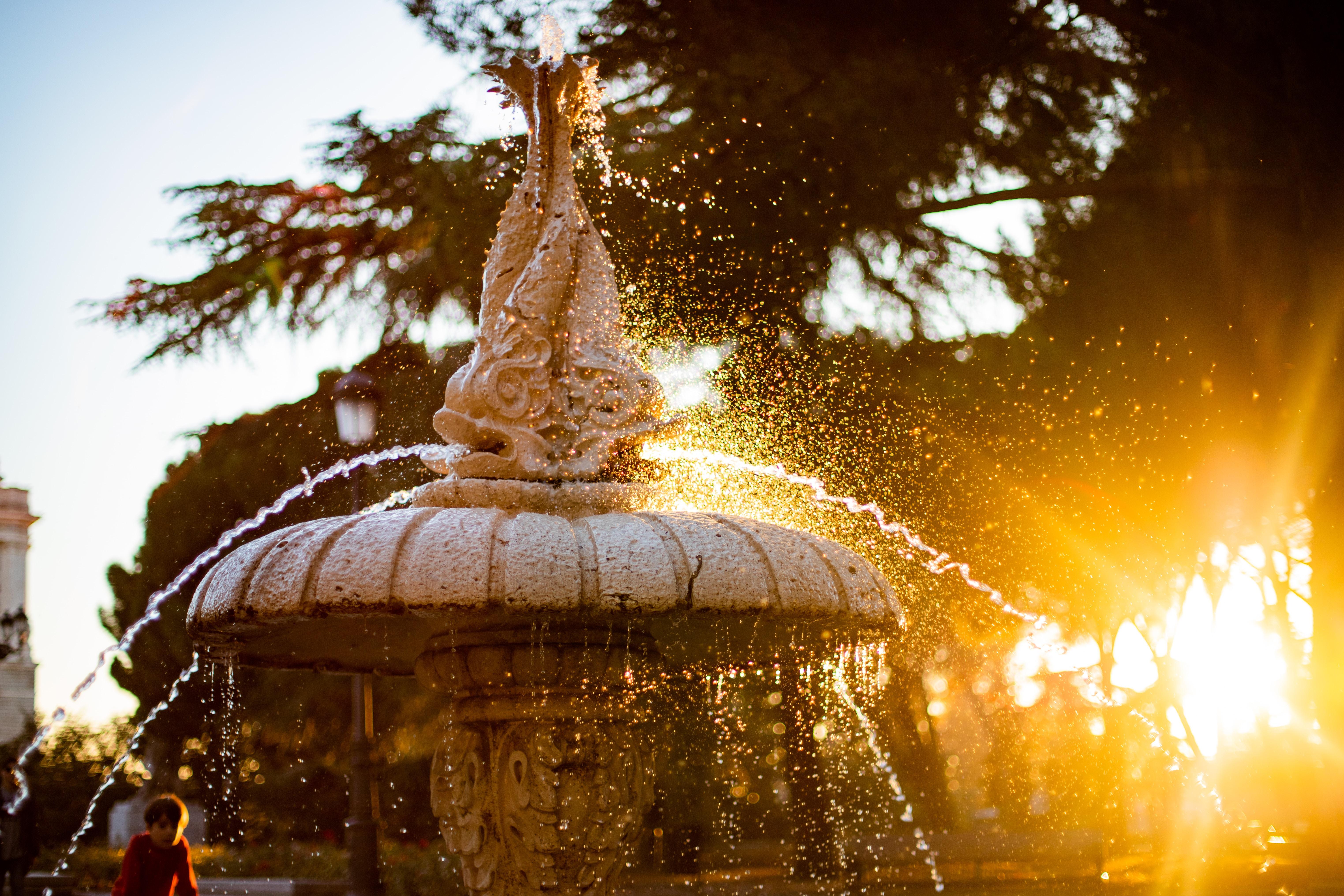 beige ceramic fountain