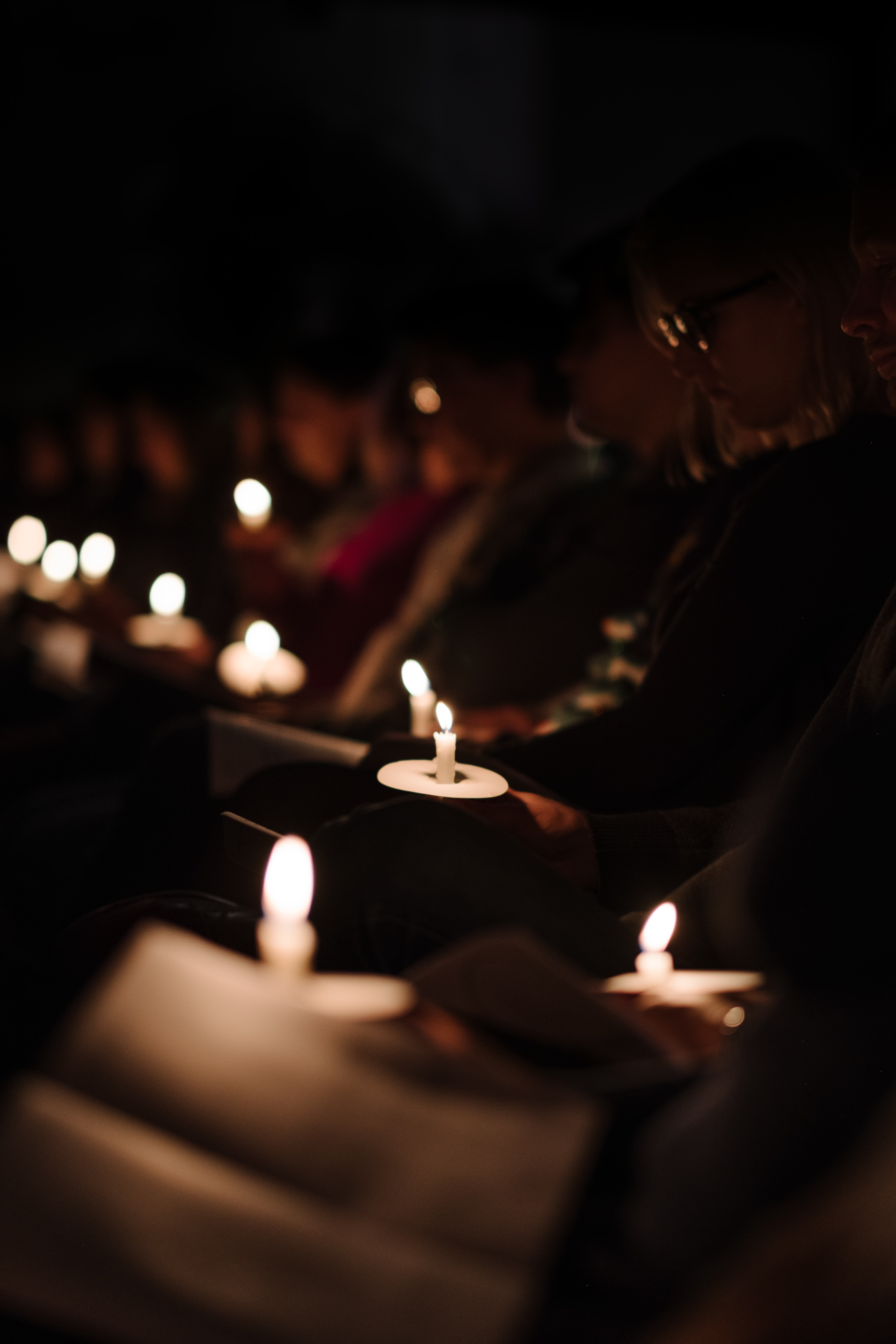 people reading books using only candles to light their view