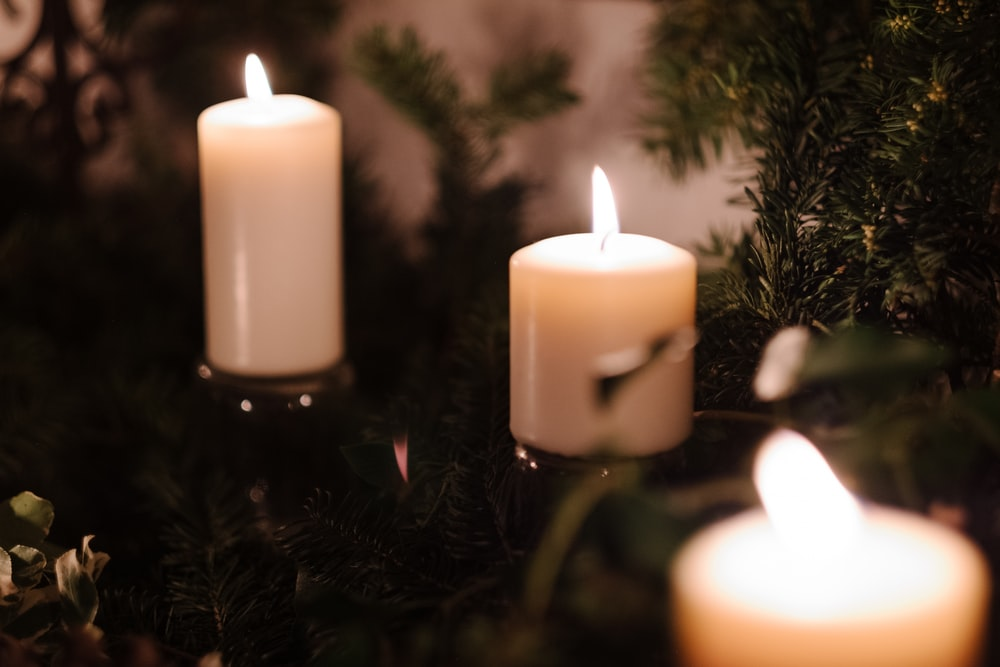 selective focus photography of three lighted candles
