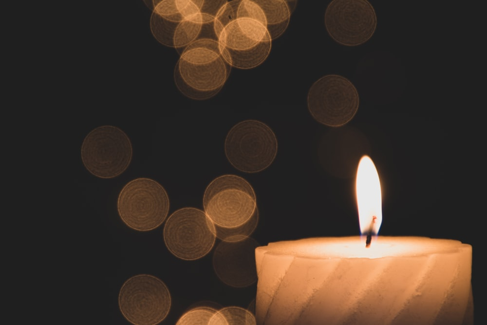 bokeh lights photography of lighted candle