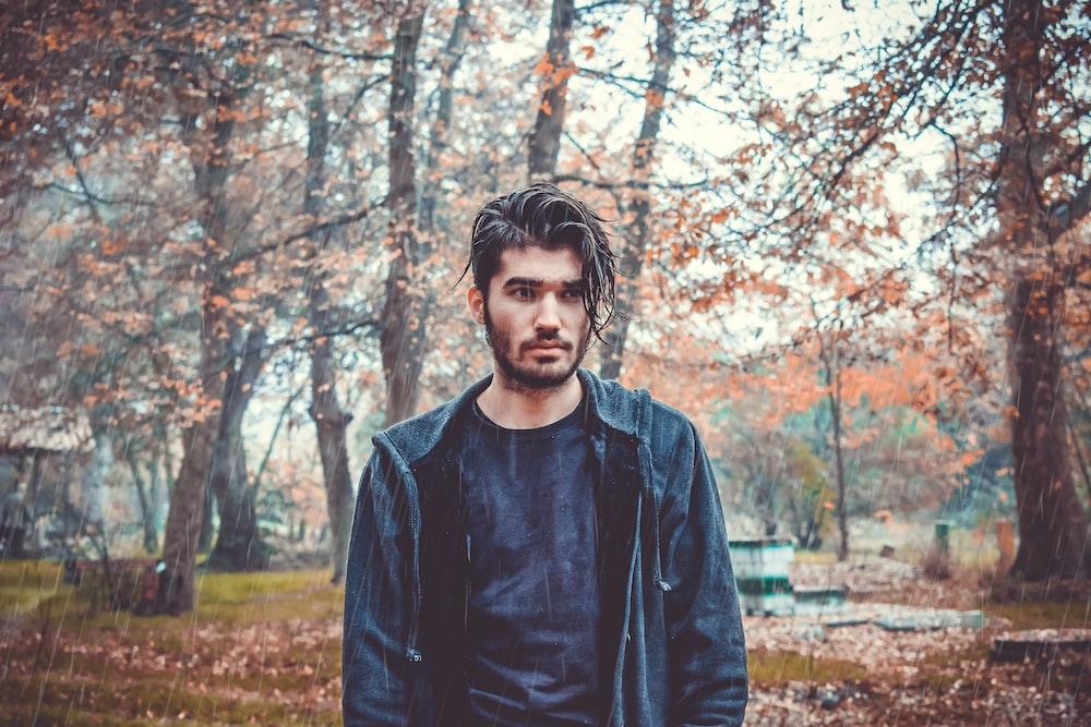 shallow focus photo of man in black full-zip hoodie