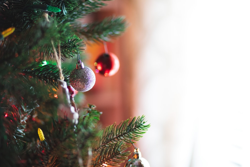 silver and red ornament on Christmas tree