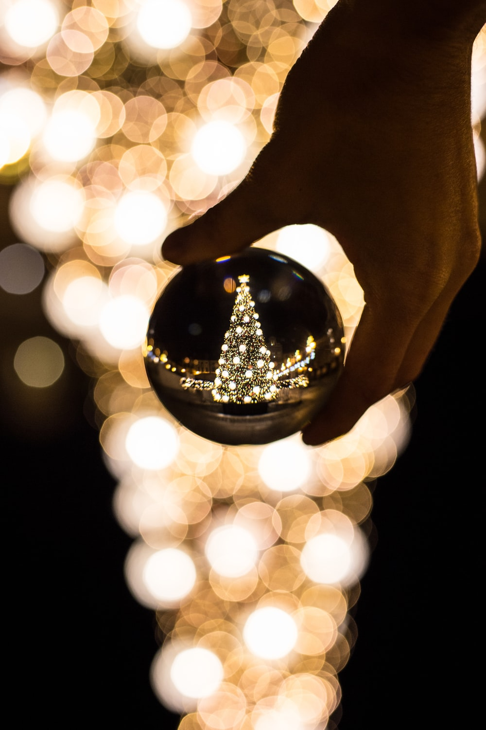 person holding glass bauble