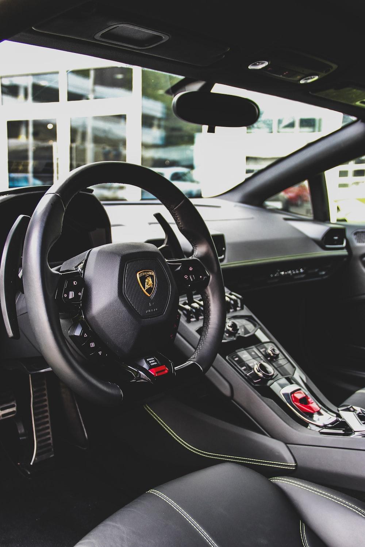 black Lamborghini vehicle interior during daytime