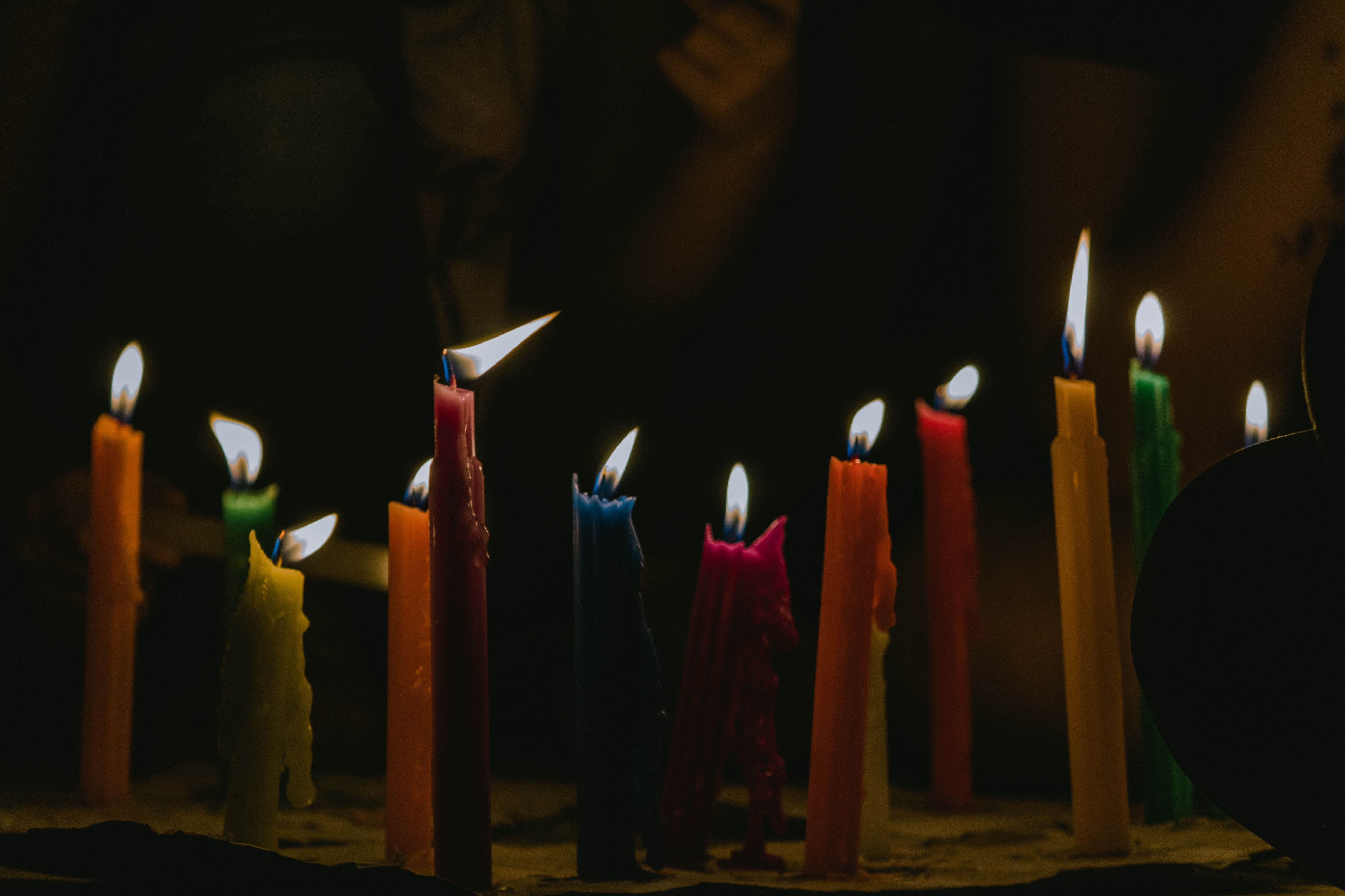 assorted-color lighted candles
