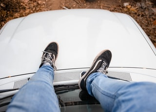 person sitting on top of car