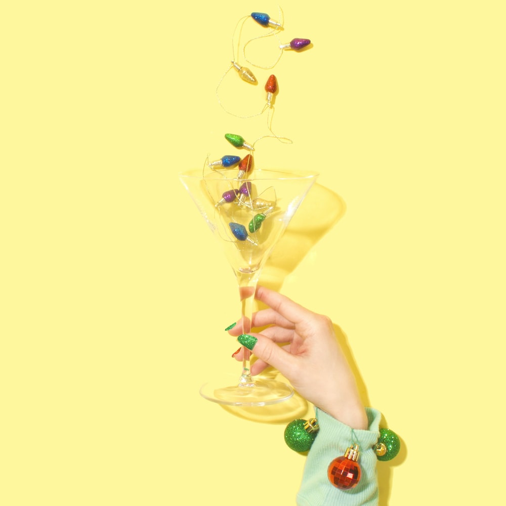 person holding cocktail glass