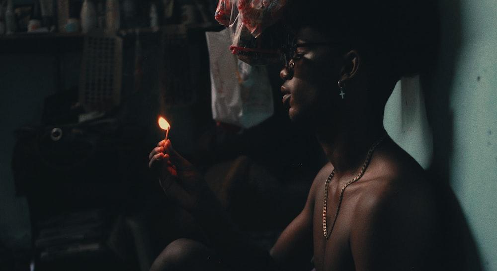 man lighting matchstick