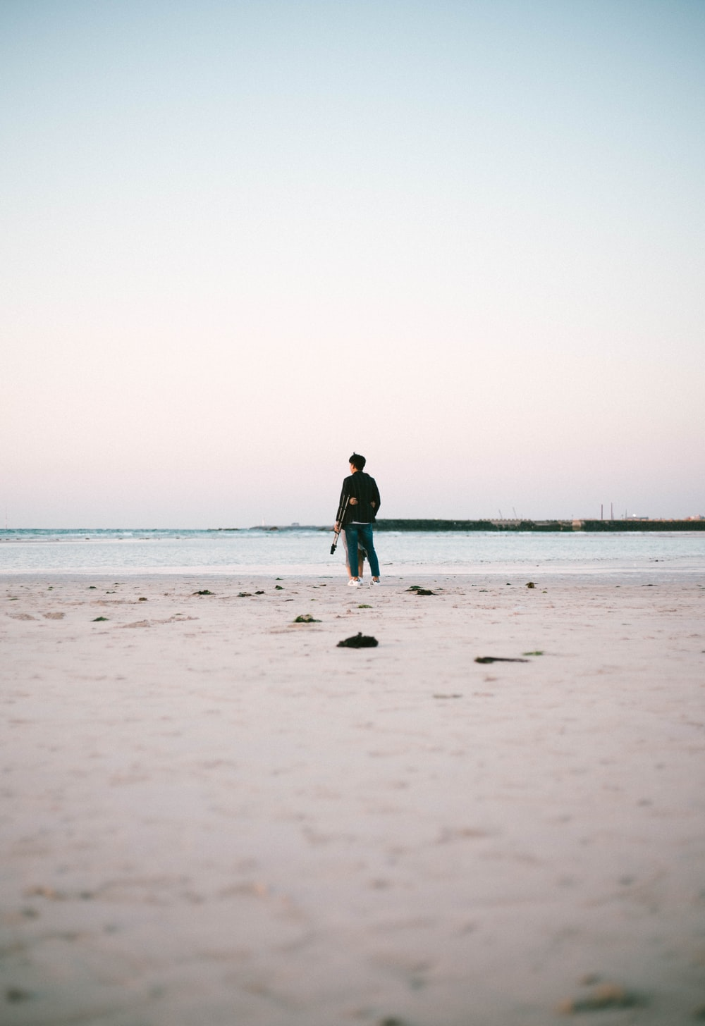 person standing beside seashore