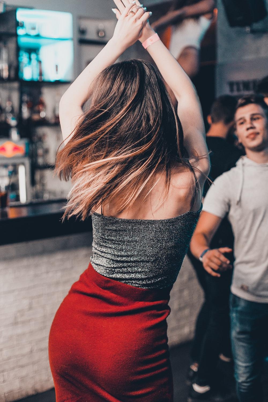dancing woman near man dancing