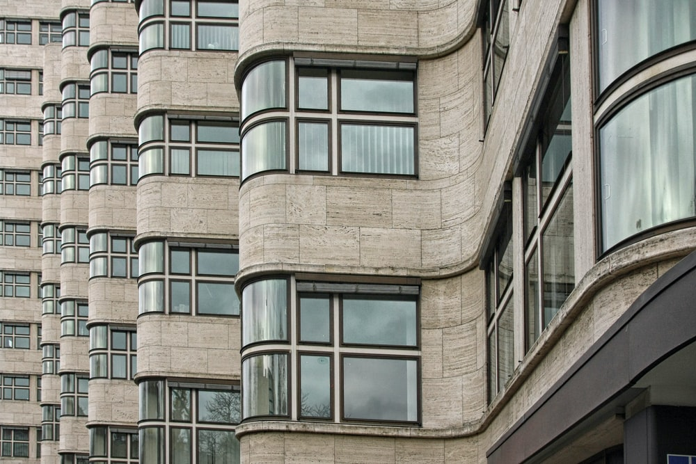 brown building curved windows design