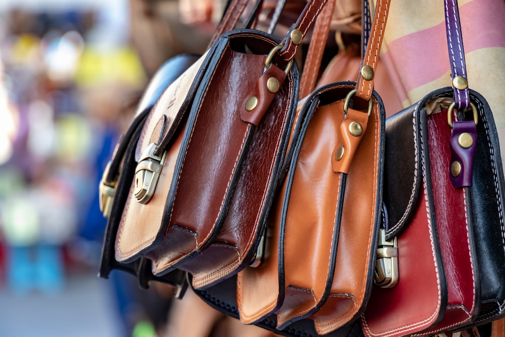 three assorted-color leather crossbody bags