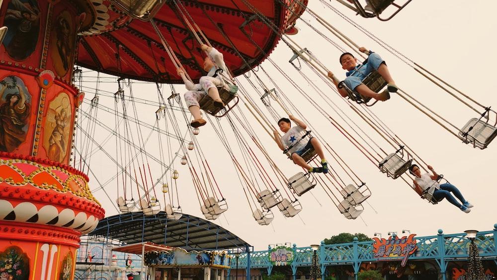 children riding merry go round