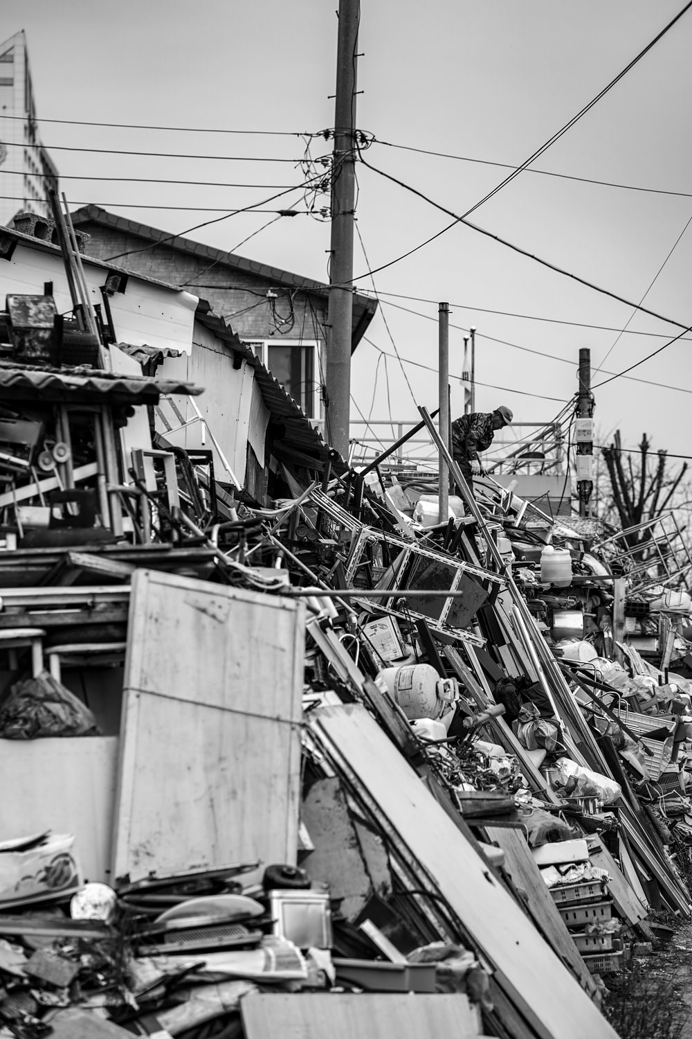 grayscale photography of wreckage of houses