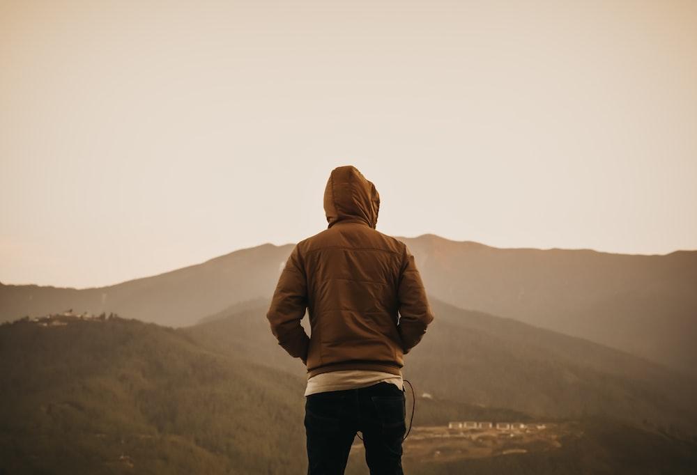 person wearing brown hoodie