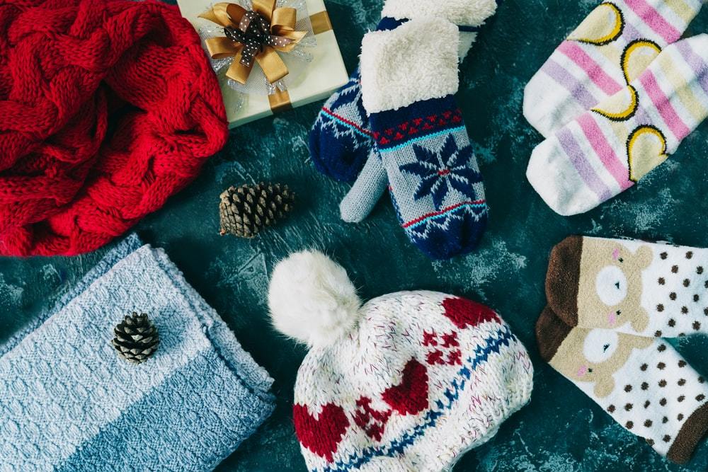 assorted socks and knit caps