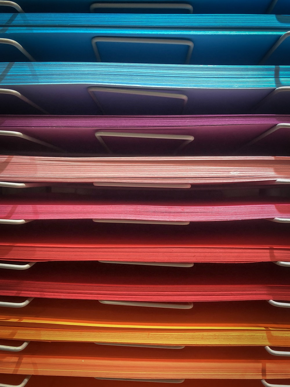 pile of assorted-color papers