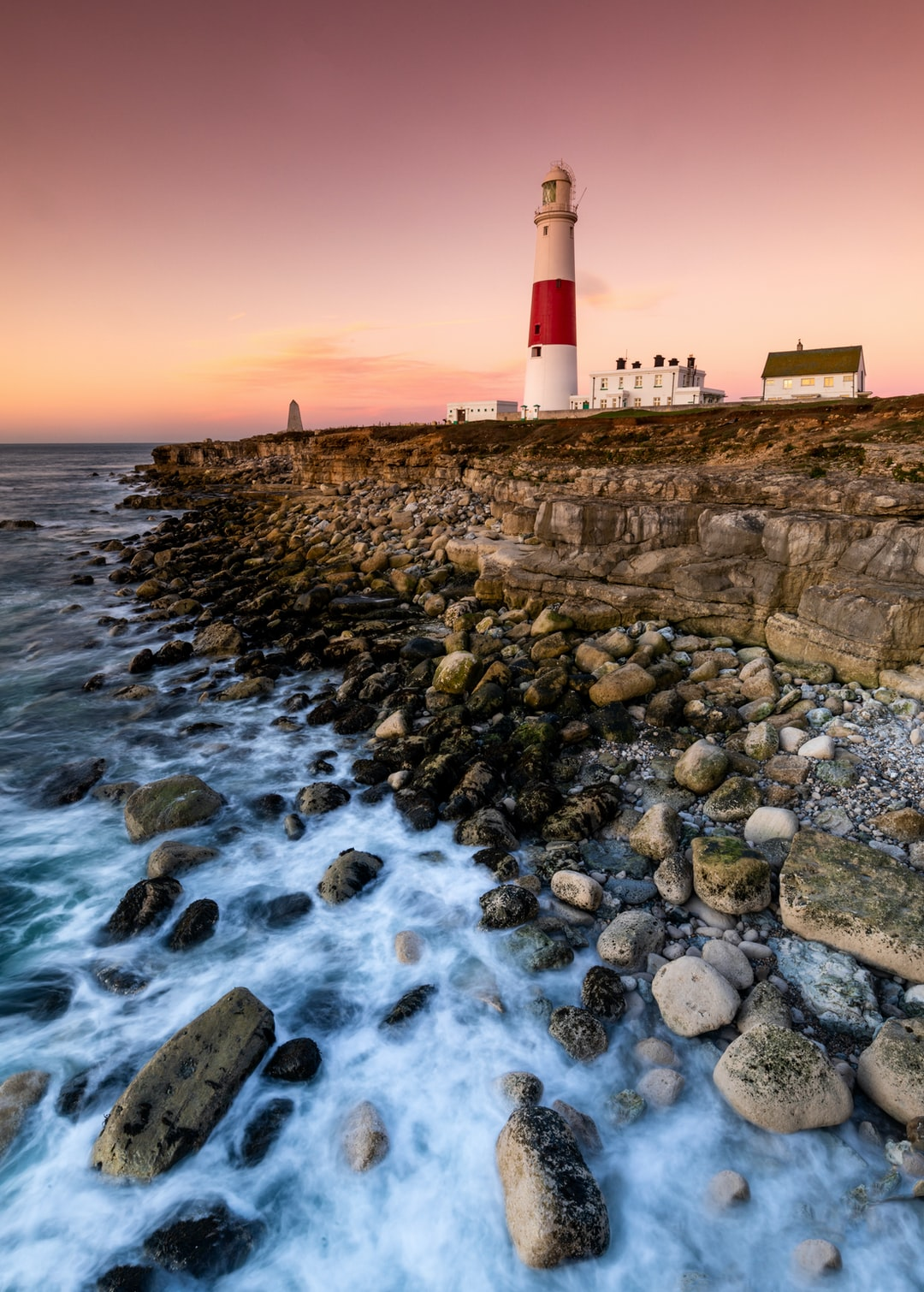 Sunrise at Portland Bill in October this year… the sunrise to the east had no cloud and not much colour, but then I looked behind me and saw these beautiful purple and pink tones, and instantly ran to the other side of Portland to capture this image