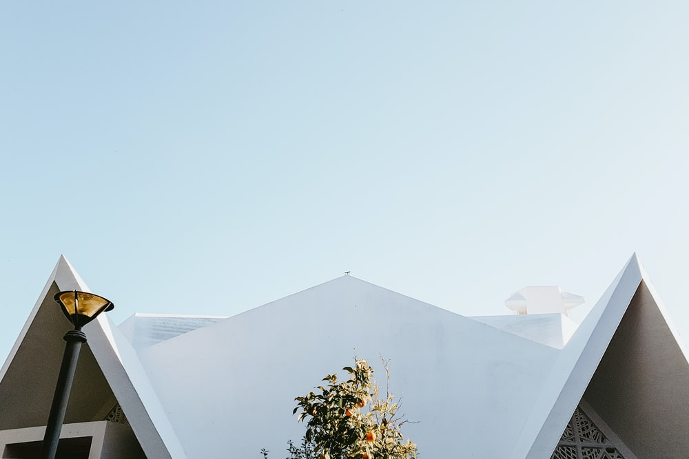 concrete church under clear sky at daytime