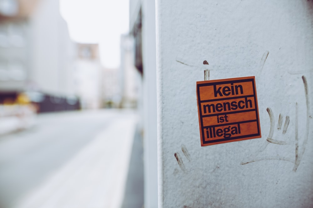 kein mench ist illegal sign sticker