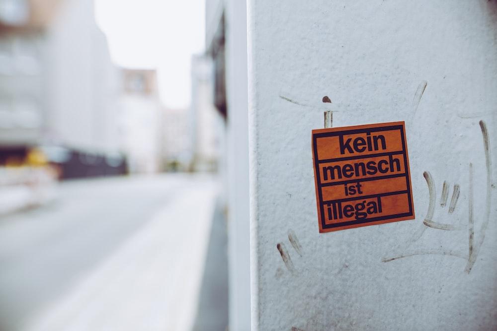 kein mench ist illegal sign sticker